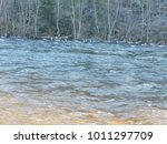 Small photo of Rolling River Running along Tree Lined Shoreline