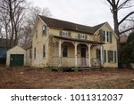 old abandoned farmhouse during... | Shutterstock . vector #1011312037