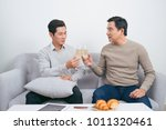 two male friends are smiling... | Shutterstock . vector #1011320461