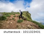 young in the mountains.the... | Shutterstock . vector #1011323431