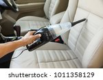 cleaning a car using a vacuum...   Shutterstock . vector #1011358129