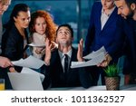 stressed male worker raises his ... | Shutterstock . vector #1011362527