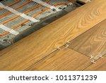 installation of ceramic tiles... | Shutterstock . vector #1011371239