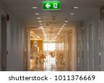 green emergency exit sign in... | Shutterstock . vector #1011376669