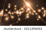 abstract gold bokeh circles on... | Shutterstock . vector #1011396001