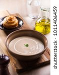 wild artichoke creme soup with... | Shutterstock . vector #1011406459