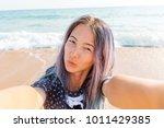 beautiful young woman taking...   Shutterstock . vector #1011429385