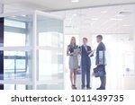business woman standing in... | Shutterstock . vector #1011439735