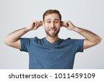 bearded attractive caucasian... | Shutterstock . vector #1011459109