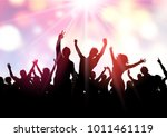 silhouette of a party crowd on... | Shutterstock .eps vector #1011461119