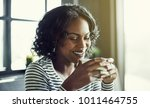 smiling young african woman... | Shutterstock . vector #1011464755