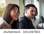 diverse group of smiling work... | Shutterstock . vector #1011467821