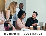 diverse group of smiling... | Shutterstock . vector #1011469735
