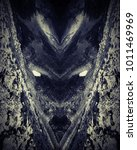 Small photo of Face of a demon, creepy surreal fantasy creature, dragon of the fairytales. Tales of the cave.