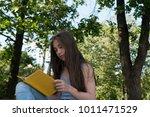 cute teenage girl reading book... | Shutterstock . vector #1011471529