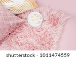 Small photo of Stylish pink pillows and cup of coffee. Copy space. Flat lay, top view