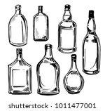 set of glass bottles. hand... | Shutterstock .eps vector #1011477001