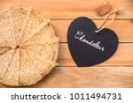 Small photo of Top view of crepes (french pancakes), word chandeleur (meaning candlemas) written on a heart, rustic wood background