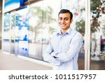 confident indian man with arms... | Shutterstock . vector #1011517957