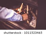 man kindle a fire in the... | Shutterstock . vector #1011523465
