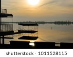 docks of a lake restaurant.  | Shutterstock . vector #1011528115