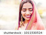 beautiful indian woman with... | Shutterstock . vector #1011530524