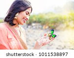 beautiful indian woman holding... | Shutterstock . vector #1011538897