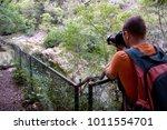 professional male photographer... | Shutterstock . vector #1011554701