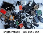 pile of used electronic waste... | Shutterstock . vector #1011557155