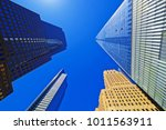 skyscrapers rising up to sky on ... | Shutterstock . vector #1011563911