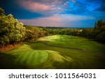 golf course fairway in colorful ... | Shutterstock . vector #1011564031