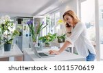 female florist standing at her... | Shutterstock . vector #1011570619