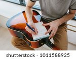 learning to play the guitar.... | Shutterstock . vector #1011588925