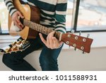 learning to play the guitar.... | Shutterstock . vector #1011588931