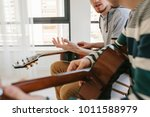 learning to play the guitar.... | Shutterstock . vector #1011588979