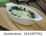 spinach bake with cheese in... | Shutterstock . vector #1011597541