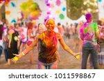 girl celebrate holi festival | Shutterstock . vector #1011598867