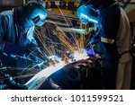 worker with protective mask... | Shutterstock . vector #1011599521