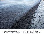 new layer of asphalt on highway.... | Shutterstock . vector #1011622459