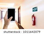 men use mobile phones in the... | Shutterstock . vector #1011642079
