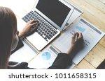 business women reviewing data... | Shutterstock . vector #1011658315