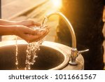Woman Washing Her Hands At The...