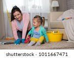 mom and daughter are cleaning... | Shutterstock . vector #1011667471