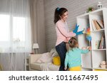 mom and daughter are cleaning... | Shutterstock . vector #1011667495