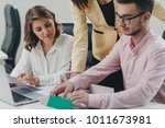 business team working on a... | Shutterstock . vector #1011673981