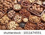 a variety of nuts in wooden... | Shutterstock . vector #1011674551