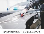 car wrapping specialist putting ... | Shutterstock . vector #1011682975