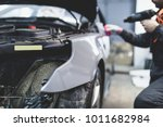 car wrapping specialist putting ... | Shutterstock . vector #1011682984