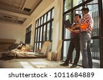 two engineers are working... | Shutterstock . vector #1011684889