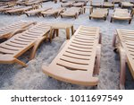 empty beach loungers on the... | Shutterstock . vector #1011697549